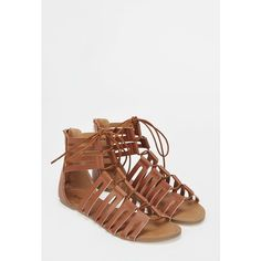 Justfab Flat Sandals Jacquie ($40) ❤ liked on Polyvore featuring shoes, sandals, brown, brown platform sandals, platform gladiator sandals, gladiator sandals, brown flats and t-strap flats