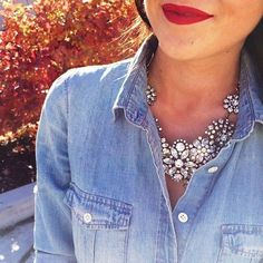 Dress up a chambray shirt by pairing with a sparkly necklace (and red lipstick). how to wear a statement necklace