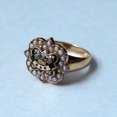 Someday soon(ish) gonna convert my pearl Phi Mu Badge into a a ring so I can wear it all the time!