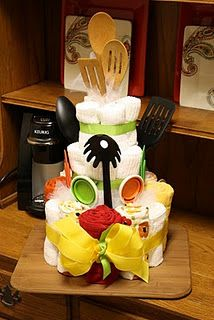 I love diaper cakes, but this gives me a reason to make something similar for wedding showers and even housewarmings. Dish towel cakes are cool. Put a bottle or red wine in the middle for extra snaz (I use prosecco in diaper cakes).