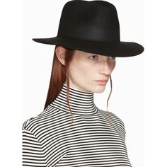 --evaChic--This Kenzo Back Zip Logo Stamp Fedora Hat features an unexpected zip detail that creates an impressive back slit and prominent logo details for a fashionista outing. Adopters of the fashionable brand will be thrilled to own a stunning collectible. It adds a mystery element to your looks and it is also a cozy winter accessory to replace your casual beanie.            http://www.evachic.com/product/kenzo-back-zip-logo-stamp-fedora-hat/