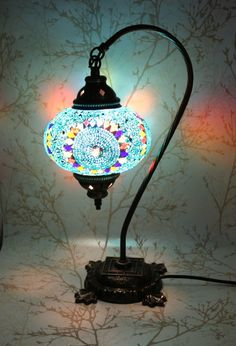 This Turkish Mosaic Lamp is made of hand-cut colored glass, and takes the shape of a swan neck - giving it yet more snazz than ever. Features - Size of the mosaic globe: 7 inches (18 cm ) diameter and