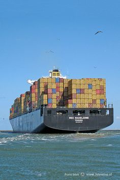 Large vessel loaded with containers, just outside the port of Rotterdam, the Netherlands