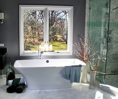 """Free standing tub by Victoria & Albert with Hansgrohe tub fill. Heated, Turkish-honed marble floor tiles in 12"""" x 24"""" sizes."""