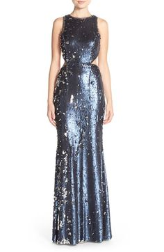 Free shipping and returns on Jay Godfrey Sequin Cutout Mermaid Gown at Nordstrom.com. Dual-finish paillettesilluminate the liquid silhouette of ashowstoppinggown enhanced by skin-baring cutoutsat the waist that further its contemporary appeal.