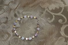 Yellow Glass, Purple and Clear Howlite, and Copper Stars Bracelet