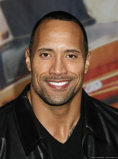 Dwayne Johnson - love his smile!  Seriously, that's what I love!