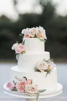 Blush and beige floral topped wedding cake: http://www.stylemepretty.com/california-weddings/st-helena/2015/12/02/rustic-chic-napa-valley-wedding/ | Photography: Caitlin O'Reilly - http://caitlinoreillyphotography.com/