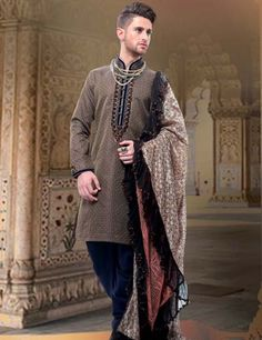 Get a royal and handsome look with this kurta suit and be in limelight at ceremonies or events. Product code - G3-MKS0338 Price - INR 6095/-