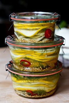 Slice summer squash, sweet onion, red pepper.  Toss with a tablespoon of salt and let drain in a colander or strainer over a bowl in the fridge for an hour or so.  In each jar, add about a tablespoon of fresh dill and a teaspoon of mustard seeds, You could add sliced red chili peppers.  For the pickle solution:  In a small pot, bring 1 cup white wine vinegar, 1 cup rice wine vinegar, 1/3 c sugar, 1 t kosher salt to a boil until sugar dissolves.  Layer squash in jars, then top off with…