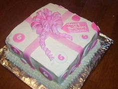 Birthday Present Cake for Little 6 year old Girl:  This cake is easy. Square cake, buttercream icing, fondant cutouts of circles and 6's. I made the bow using Gum Paste. It holds it's shape stronger if