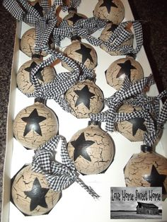 My hand painted Christmas glass ornaments. Crackle tan with black prim stars. Black gingham homespun ties.   Check me out on ebay!