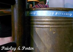 """it's a boy"" ribbon on copper planter for wrapping paper and ribbon disposal after opening gifts"