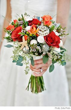 Materials   - Store bought seashells and pearls   - Hot glue gun and glue   - Floral wire with ribbon   - Your favourite flowers (or already purchased bouquet)    Tip: While adding shells and beads, be sure to keep in mind that you'll be holding the bouquet – so place them accordingly.