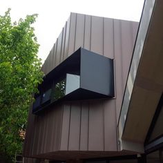 VM Zinc Pigmento Red variable width standing Seam panels. We just love this look. Installed by @designcladdingsystems #archclad #vmzinc…