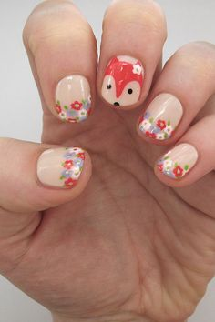 Try this easy nail art tutorial featuring everyone's favorite woodland creature hiding amid a field of floral fingertips. What does the fox say? Super cute! - DivineCaroline.com