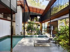 Completed in 2016 in Noosa Heads, Australia. Images by Toby Scott. . Mitti Street House is situated in a low-lying area at the eastern edge of Little Cove bordering Noosa National Park. The house and courtyards are...