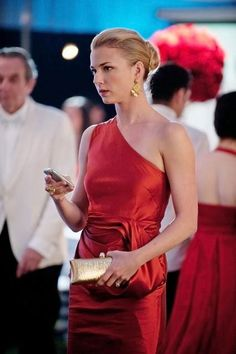While Emily Thorne always brings the glam, her Fire & Ice party dress by Vera Wang was - dare we say? - to die for. Check out more Fire & Ice fashion in this behind-the-scenes video of Revenge.