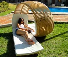 Lounge with a friend or loved one sitting right next to you with this stylish double patio lounger known as the Loopita Bonita. Designed by Victor Aleman