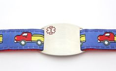 """Our new """"Keep Truckin'"""" children's sport bracelet is a great way to keep your little one safe and identified! This bracelet is extremely comfortable as it is made of nylon and polyester with an adjustable snap closure allowing it to be custom fit to your child's wrist size.  $19.95"""