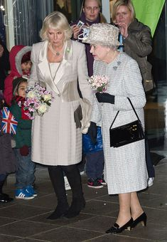 Queen Elizabeth ll and Camilla, Duchess of Cornwall, wearing a grey coat and dress by ex-Barnado's boy Bruce Oldfield visit the new Barnado's Headquarters in Barkingside on December 2013 in. Camilla Duchess Of Cornwall, English Royal Family, Camilla Parker Bowles, Prince Charles And Camilla, Royal Queen, Elisabeth, Herzog, Queen Victoria, Royals