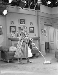 Lucille Ball vacuuming in her mink coat... I would probably be in comfy pants with my Burberry slippers on❤I love Lucy!!