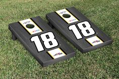 Our NASCAR KYLE BUSCH #18 CORNHOLE GAME SET ONYX STAINED STRIPE VERSION. Get your custom set at victorytailgate.com