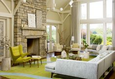 Love the driftwood in the corner, the windows, and light sectional, also the color