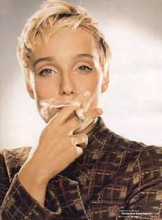Kristin Scott-Thomas smoking.
