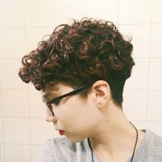 You can keep all of your curls at the top of your head with this pixie.