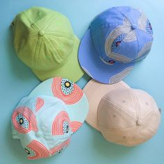Leather & printed caps in bright shades.