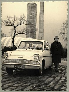 An elderly woman posing with a Ford Anglia on a bleak winter's day. The car is registered in the city of Vienna. Country of origin: Austria Ford Motor Company, Ford Anglia, Ford Classic Cars, Henry Ford, Love Car, Great British, Country Of Origin, Old Cars, Vintage Photos