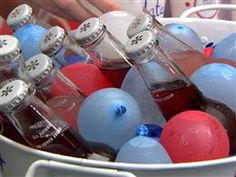 Martha Stewart 4th of July ideas! Freeze water balloons and use as ice with drink bucket.