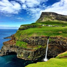 The Faroes Islands in Kingdom of Denmark are a delicate place of shimmering fjords, vertical cliffs and sweeping, vibrantly green valleys - gloriously adventure, just a two-and-a-half hour flight from the UK. Photo by tarkebauer via Instagram. #travel #denmark #amitrips