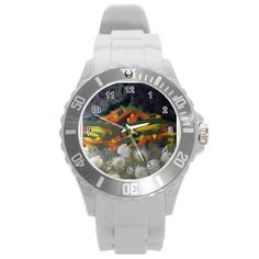 All appleartcom's products are from the original paintings of the artist/designer Jocelyn Apple. Kindly see: (www.facebook.com/appleartcom)    (www.cowcow.com/appleartcom). La Tristesse UNISEX Plastic Sport Watch (Large) by JOcelyn APple Round Plastic Sport Watch (L).This photo sport watch makes a perfect timeless gift for men and women, even for kids.  Available in 6 colors, easily add a p...
