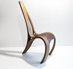 A curvaceous chair designed to provoke and engage, this piece would make a dramatic statement in any room. Made using steamed English Beech,