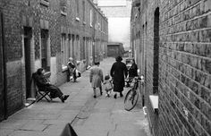 1st October 1938: A narrow street off Whitechapel High Street in the East End of London.