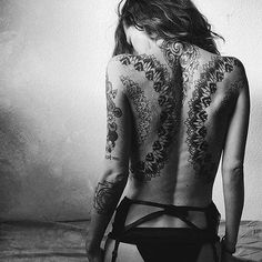 Mandala back tattoo - A wider range of mandala tattoos in black. They are best seen in black ink and incorporate well detailed designs inside the circle as well as some minor details outside.