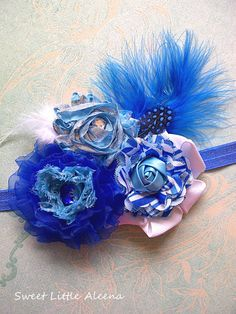 Baby Girls Bright Royal Blue Flower Headband,Big Fancy Feather Hair Bow Clip for Spring. $13.50, via Etsy.