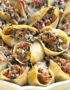 The filling for our sausage stuffed shells recipe with spinach isn't overly gooey or soft, so not only do they make for an excellent dinner served with a salad on the side, they double as finger food for your next party. From inspiredtaste.net | @inspiredtaste