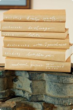 Recover books with craft paper, use white gel pen for titles.