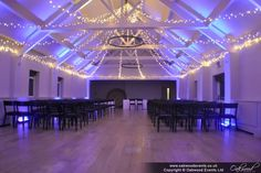 Fairy light star canopy at Stoke Place with cool uplighting for a chic wedding