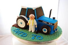 Ford Tractor cake - A 3d Ford tractor cake for a bowling-mad farmer's birthday! It was supposed to be finished with a brown ribbon around the cake drum (to represent the earth), but I couldn't find my ribbon box! Luckily the client didn't mind :)