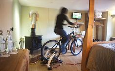 B&B (Cottage Lodge) in the UK  installs bicycle-powered television. Also, low energy lighting,  solar panels, wood stove for heating water, furniture all used from recycled materials and naturally felled trees, lo-flow toilets/showers