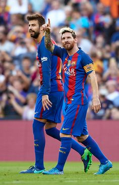 Lionel Messi of FC Barcelona celebrates scoring his team's fourth goal with his teammate Gerard Pique during the La Liga match between FC Barcelona...