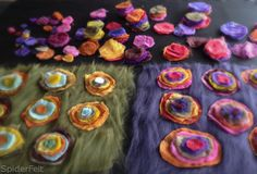 Made Merino prefelt, cut circles from those, layered, felted, sewed tiny zigzag around each color. I LOVE THESE!