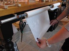 reuse Curtain rod and attach to cutting board to hold rolls of paper [Craft, organizing, storage]