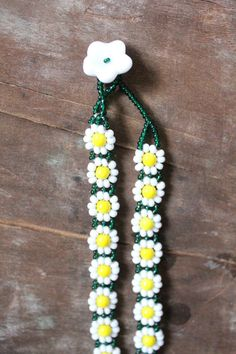 Such a darling daisy chain! This 90s hand beaded choker is in glass beads and a daisy chain design...reminds me of day dreaming at the park, making