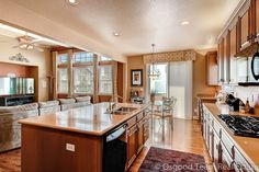 Beautiful kitchen open to great room. Center island, gas cooktop, upgraded cabinetry with crown molding.