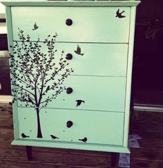 Paint an old dresser then either stencil on design or apply wallpaper or wall decals